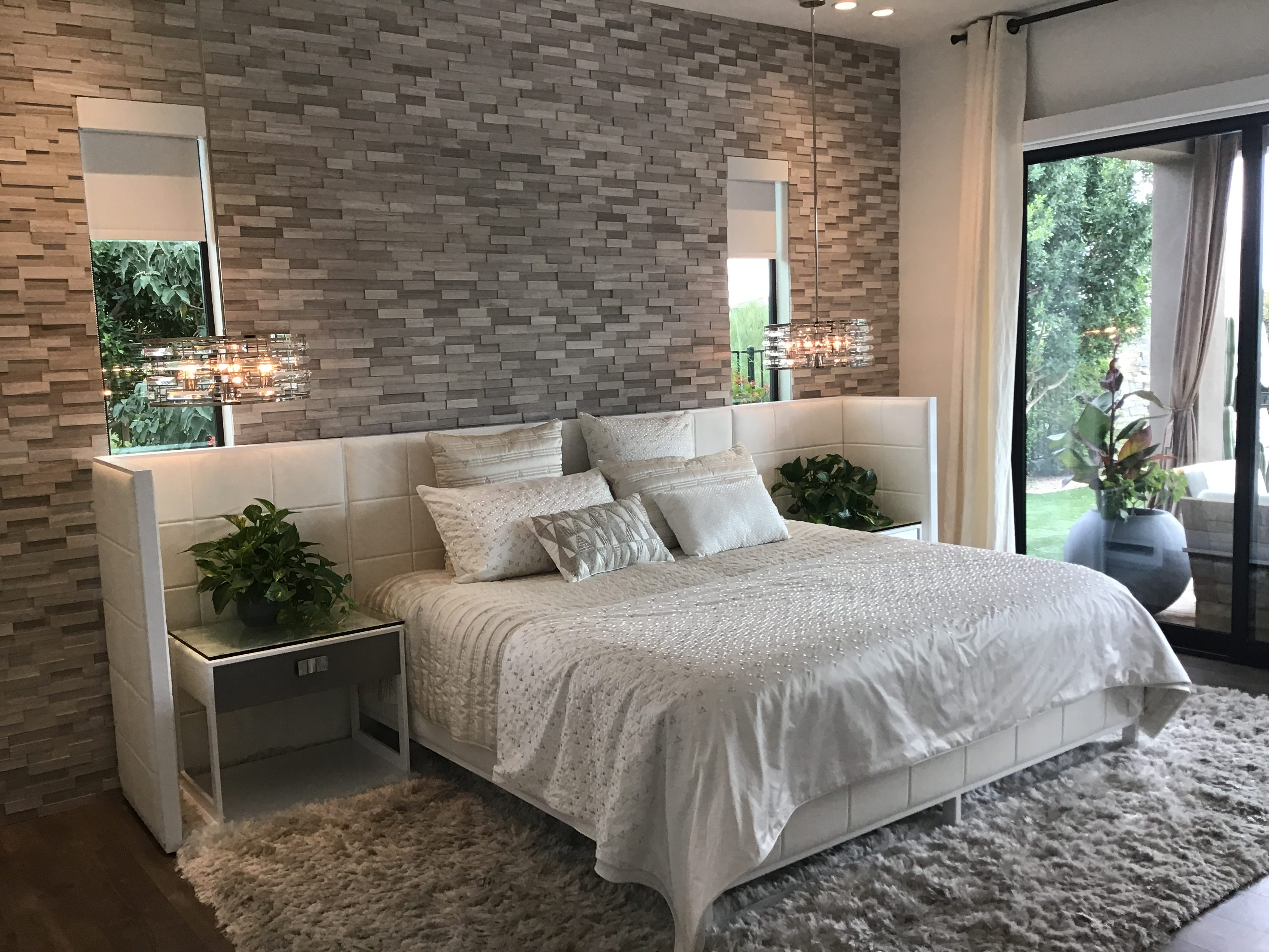Kim Farrell, who wanted to be a designer when she was younger, chose all the finishes in the home, such as this stone wall.