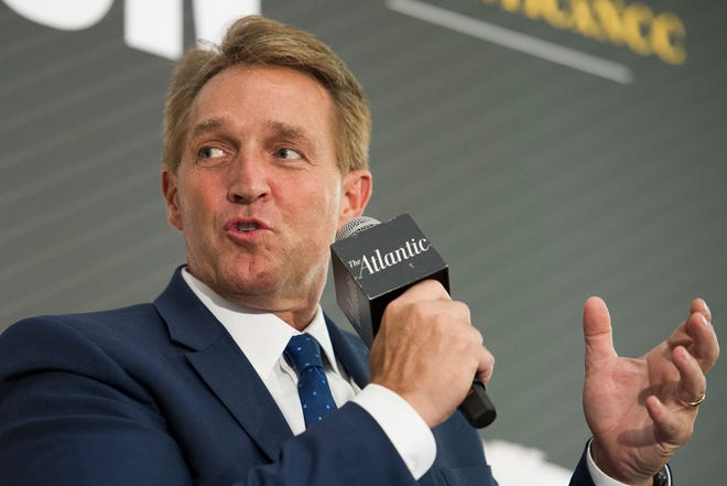Sen. Jeff Flake, R-Ariz., seen here in Washington, D.C., on Oct. 2, 2018, says he likes conservative policy but still feels like he has to call out President Donald Trump when he disagrees with him.