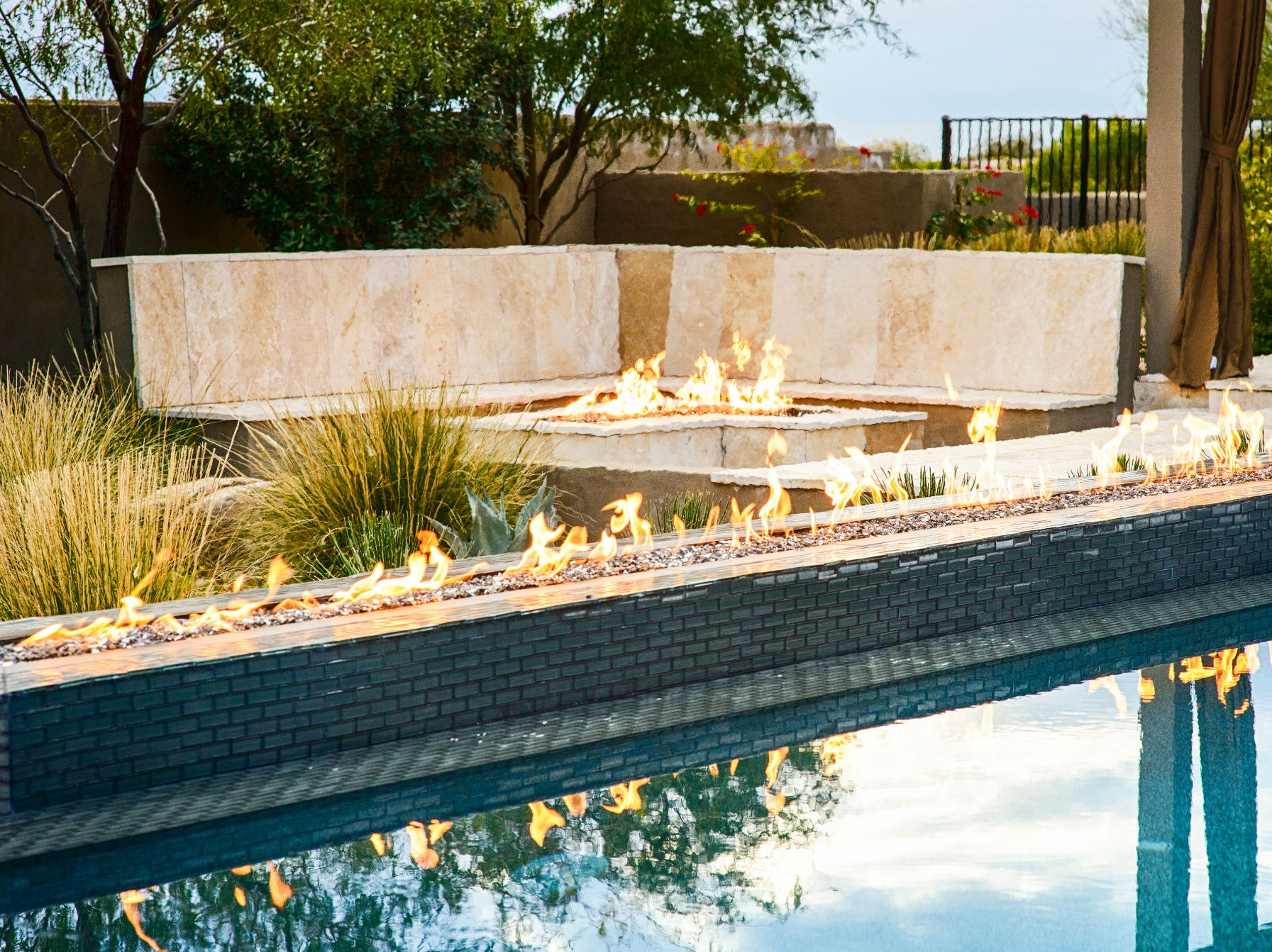 Fire and water are key elements in this backyard, which was designed by Rain Dance Pool & Landscape.