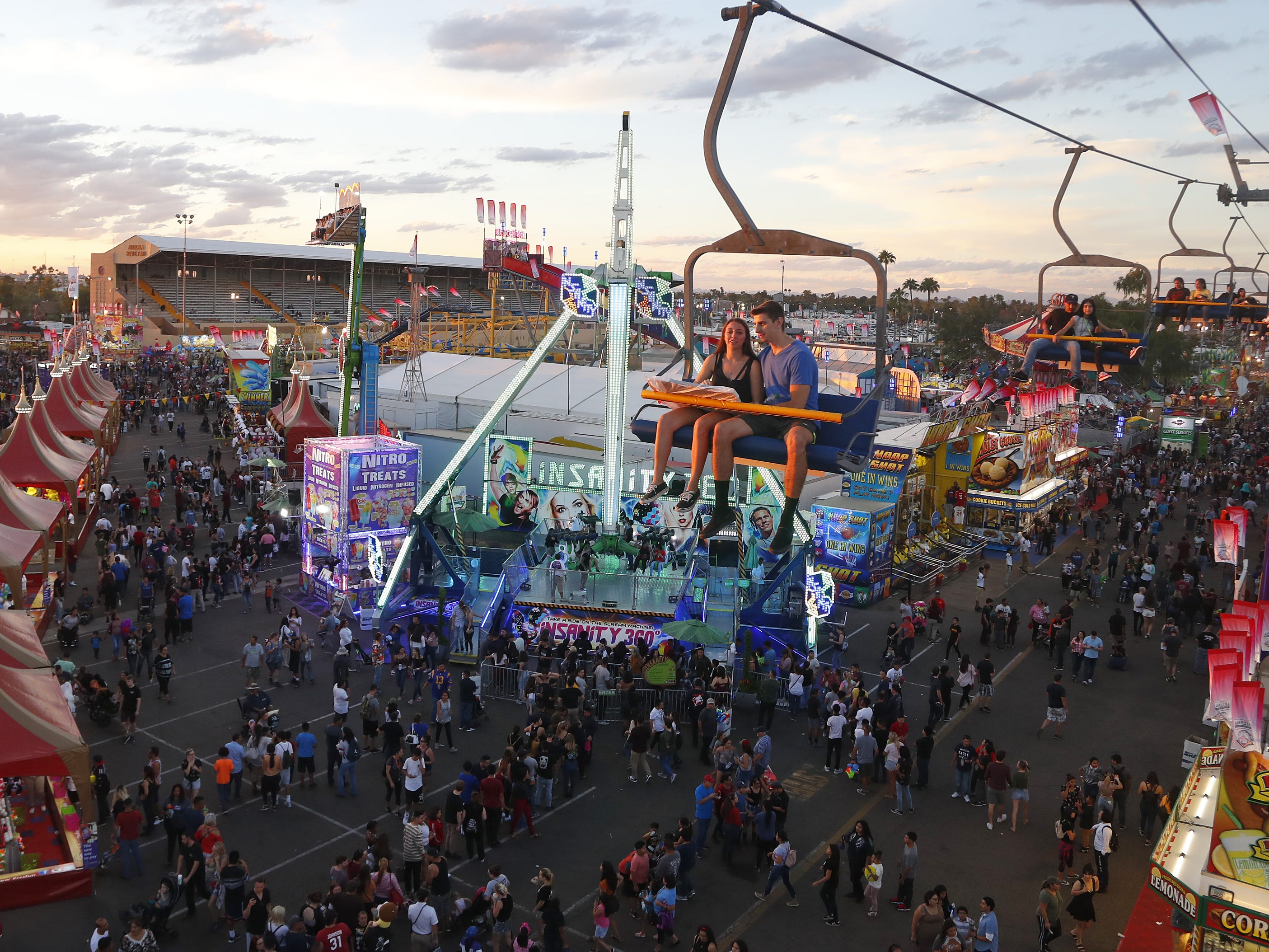 Fair-goers check out the sky ride at the Arizona State Fair in Phoenix, Ariz. on October 21, 2018.
