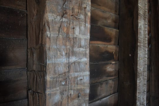 These hand-hewn beams inside Genoa's Heritage Hall were likely made from wood harvested locally.
