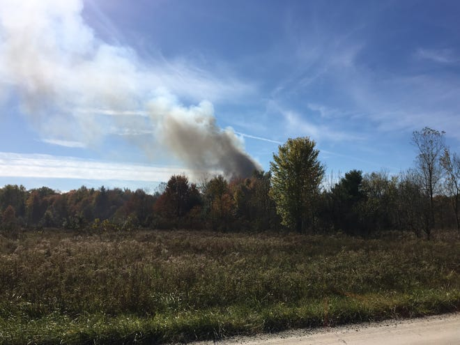 Smoke is seen billowing from a structure fire off Stein Road in St. Clair Township.