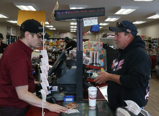 Paul Mangarella of LaGrange purchases his Mega Million lotto ticket from Kevin Borchardt, manager of the Vassar Road Stewart's in the Town of Poughkeepsie on October 22, 2018.