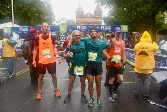 Doug Needham, left, and Alexis Ojeda pose together at the Hartford Marathon.