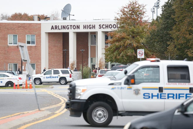 Dutchess County Sheriff's department vehicles block access to Arlington High School during a lock down on October 22, 2018.