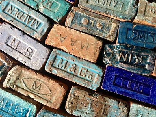 "Detail of  ""Hudson River of Bricks"" installation by Poughkeepsie artist Julia Whitney Barnes. It runs  130 feet across the floor at the Poughkeepsie Trolley Barn."