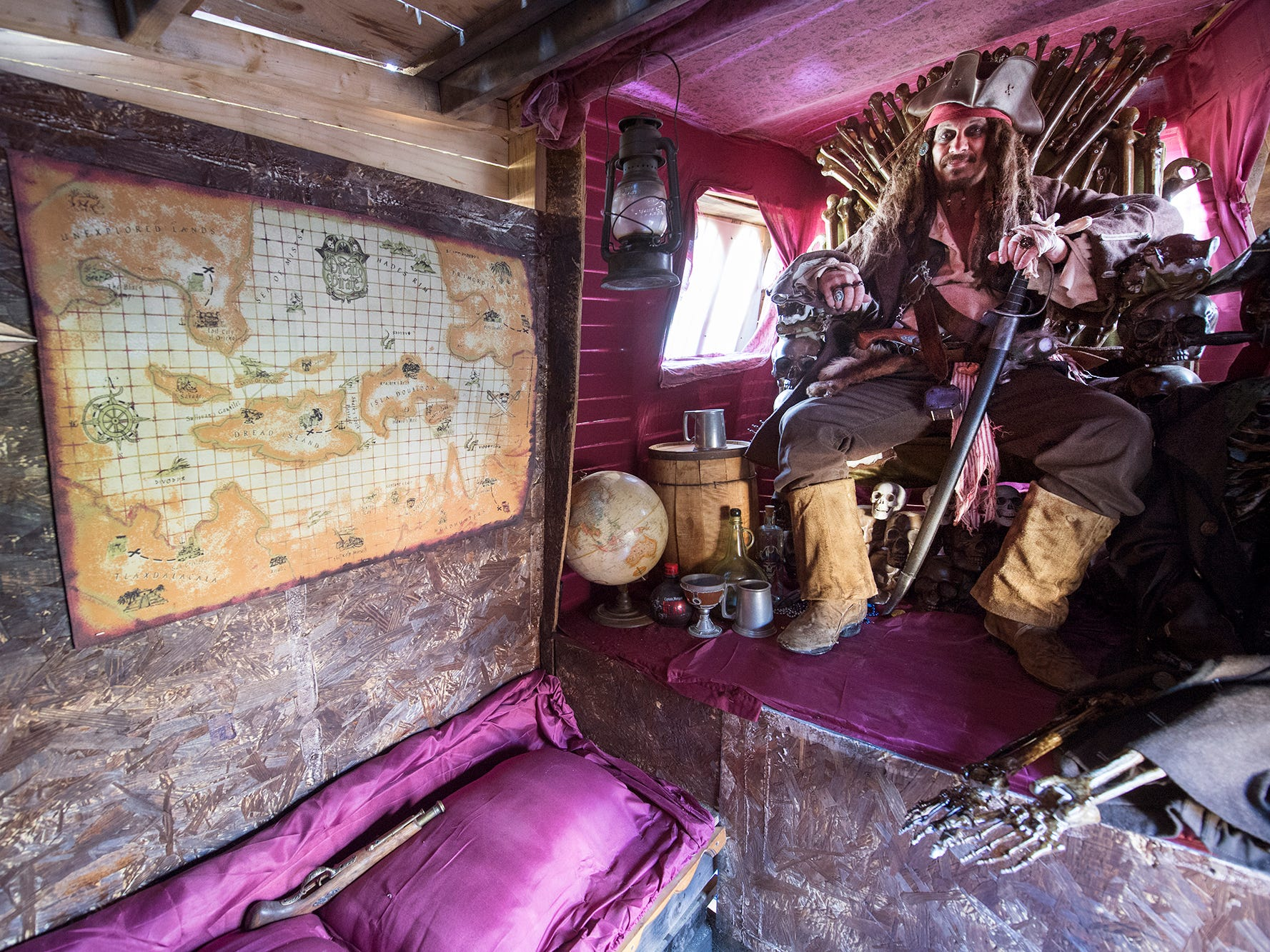 Every pirate ship needs a good map. A.J. Rosbrook is seated in the bone room at the rear of his pirate ship during the 53rd Annual Manchester/Mt. Wolf Halloween Parade.