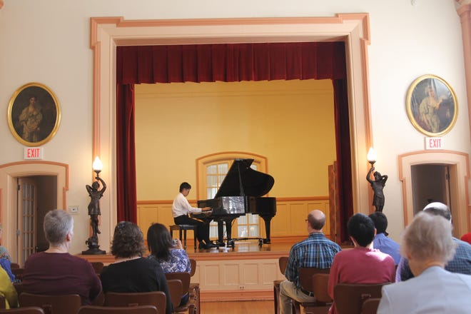 Pianist Kurtis Zhang performs on the stage of the Hugh McCall Mansion (former Woman's Club of York) during a Matinee Musical Club program on Sunday, Oct. 7.
