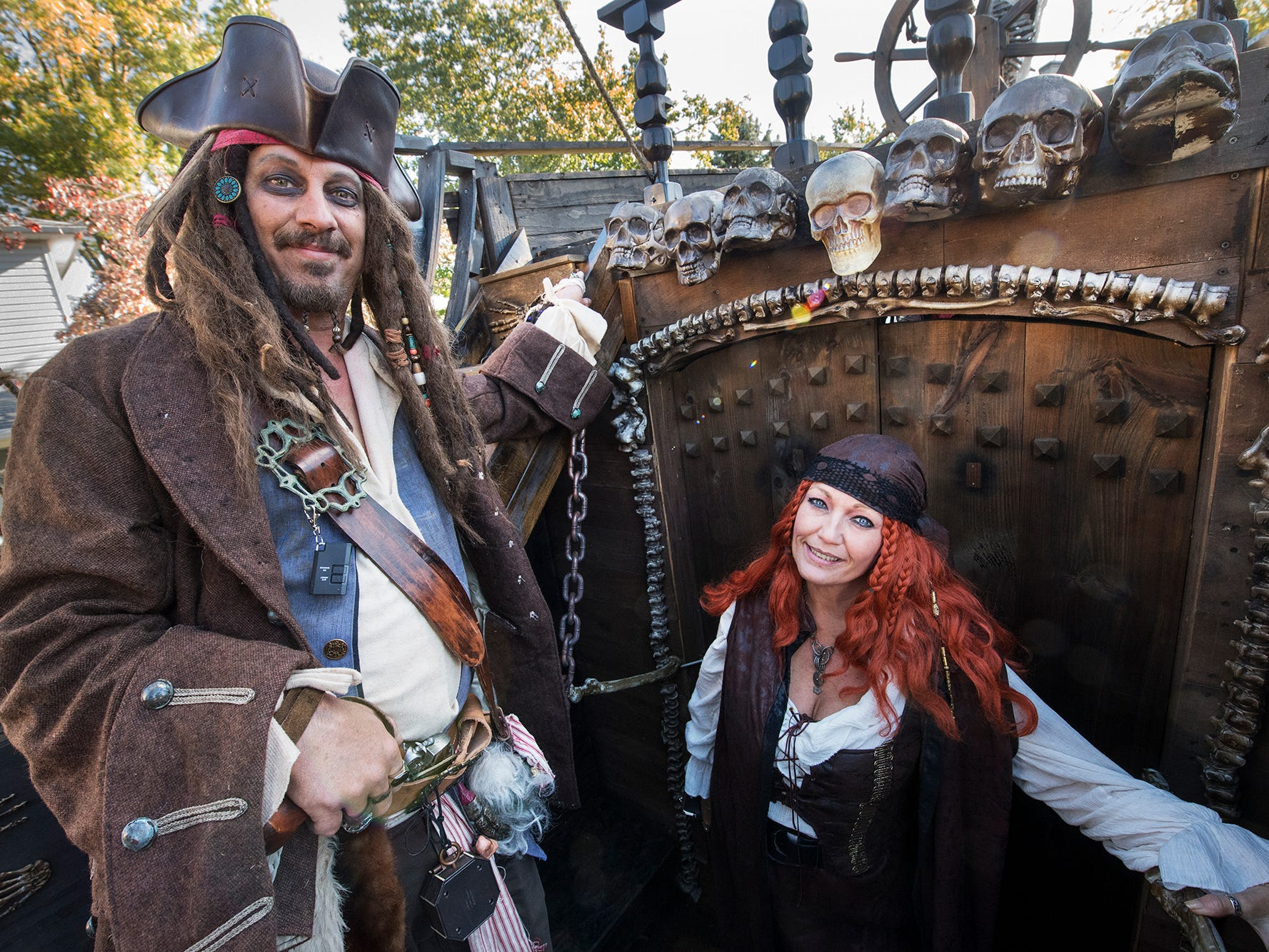 A.J. Rosbrook, left, stands with his wife, Traci, on the deck of the pirate ship during the 53rd Annual Manchester/Mt. Wolf Halloween Parade.