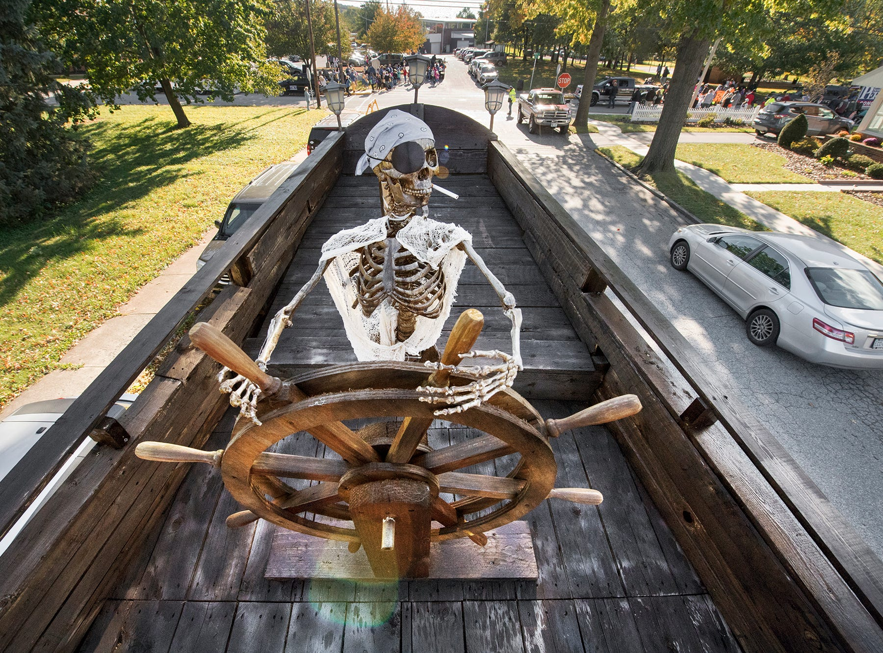 The ship's wheel is manned by a skeleton on the bow of the pirate ship during the 53rd Annual Manchester/Mt. Wolf Halloween Parade.