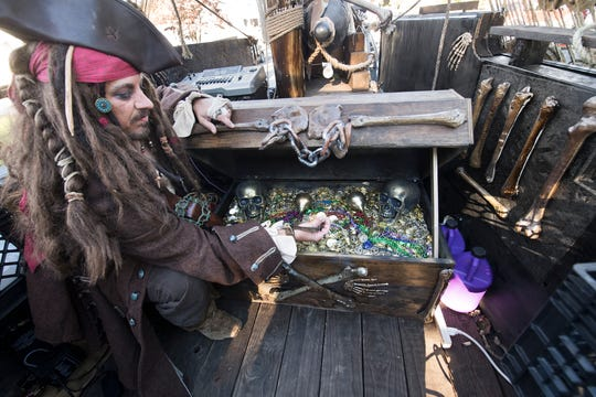 A.J. Rosbrook checks on his treasure chest on-deck during the 53rd Annual Manchester/Mt. Wolf Halloween Parade.