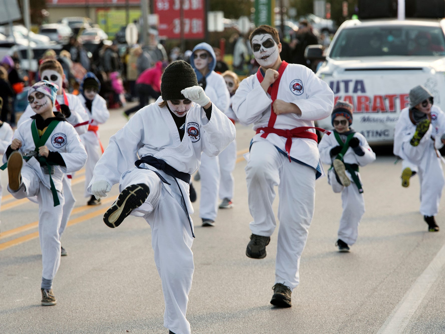UTA Karate Manchester makes their way up Main Street in Manchester during the 53rd Annual Manchester/Mt. Wolf Halloween Parade.