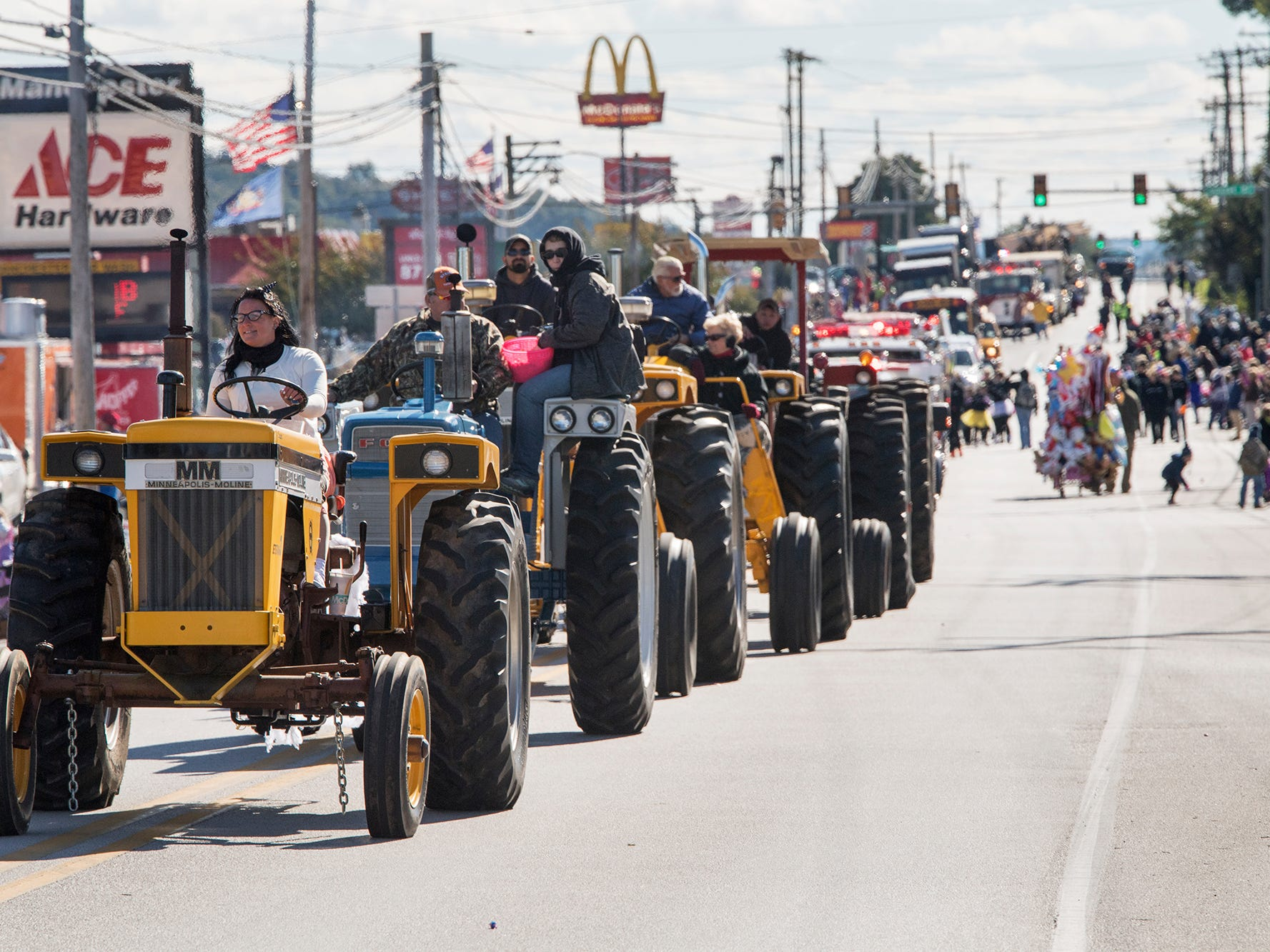 A line of tractors promotes Olde Tyme Days during the 53rd Annual Manchester/Mt. Wolf Halloween Parade.