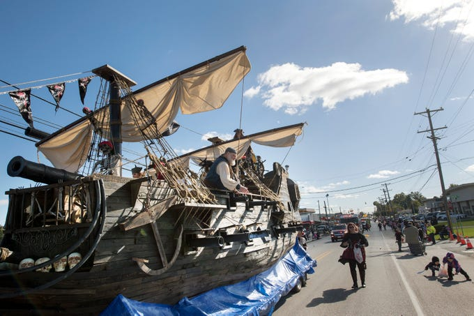 A.J. Rosbrook's pirate ship heads north on Main Street in Manchester during the 53rd Annual Manchester/Mt. Wolf Halloween Parade Sunday. Rosbrook said that most of the materials used to build the ship was wood crating donated by Wolfgang Confectioners.