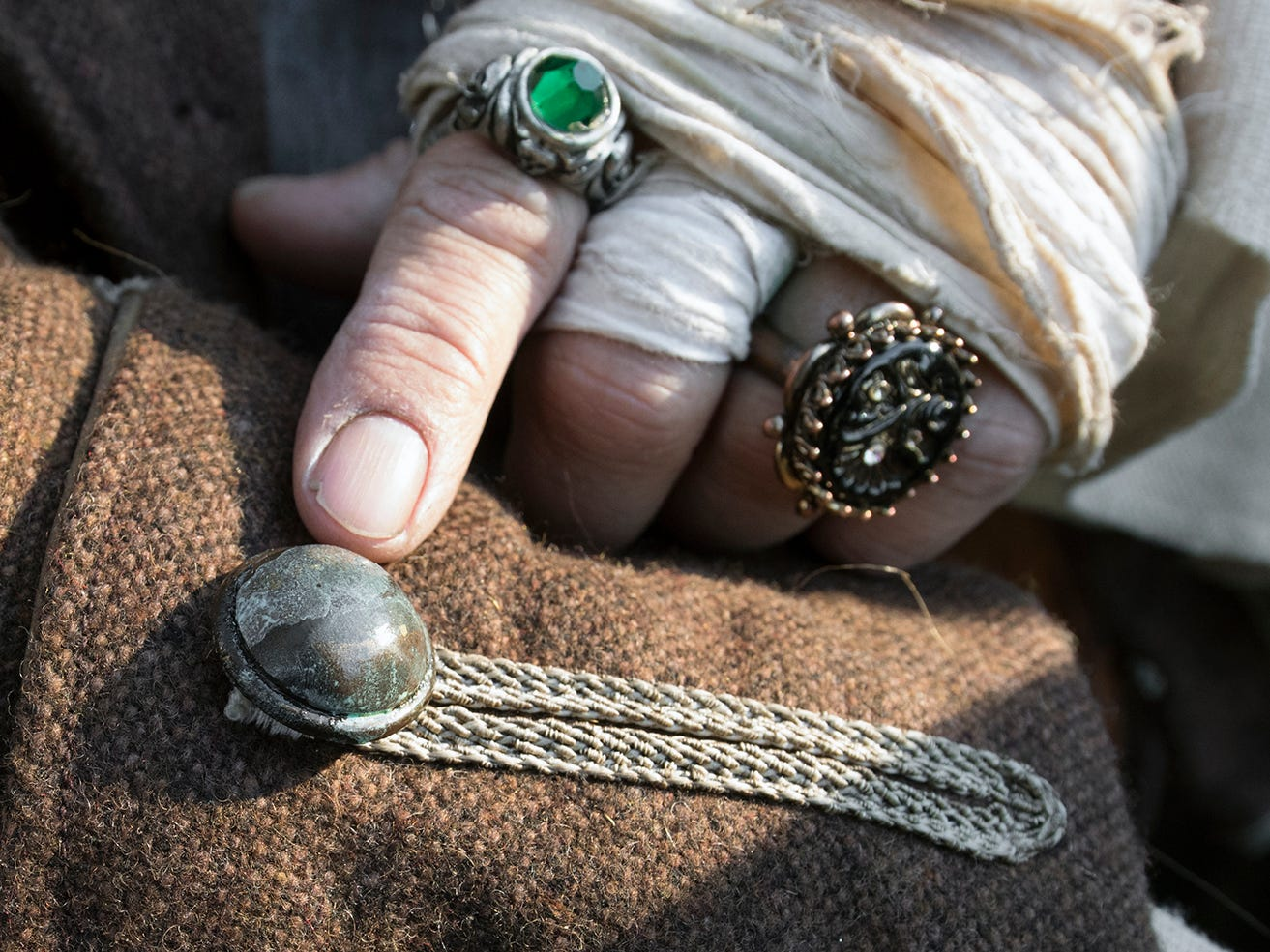 """According to A.J. Rosbrook, he obtained surplus buttons that were made for the """"Pirates of the Caribbean"""" movie series costumes. Rosbrook sewed his own jacket from a pattern."""