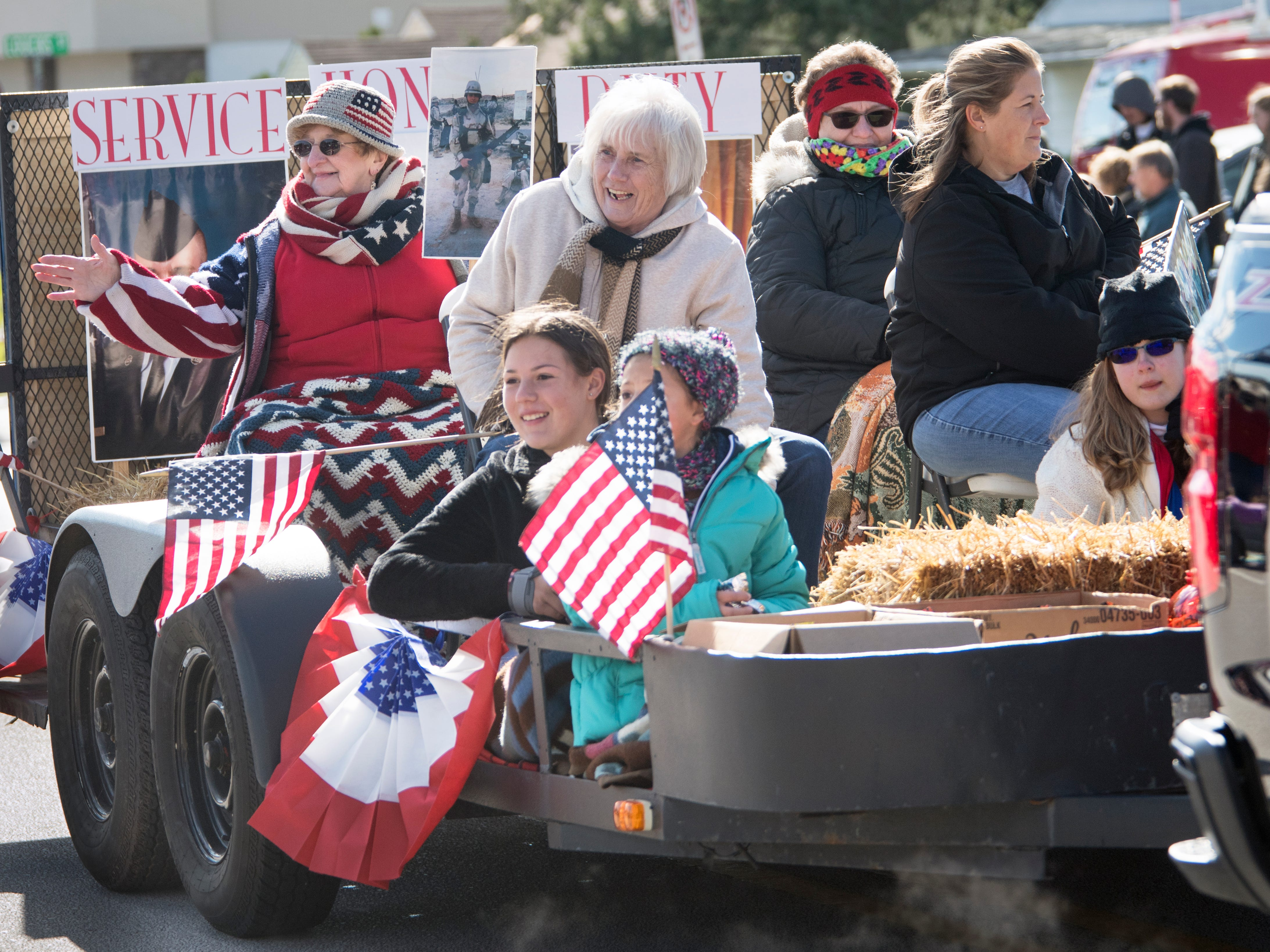 Participants wave from a float during the 53rd Annual Manchester/Mt. Wolf Halloween Parade.