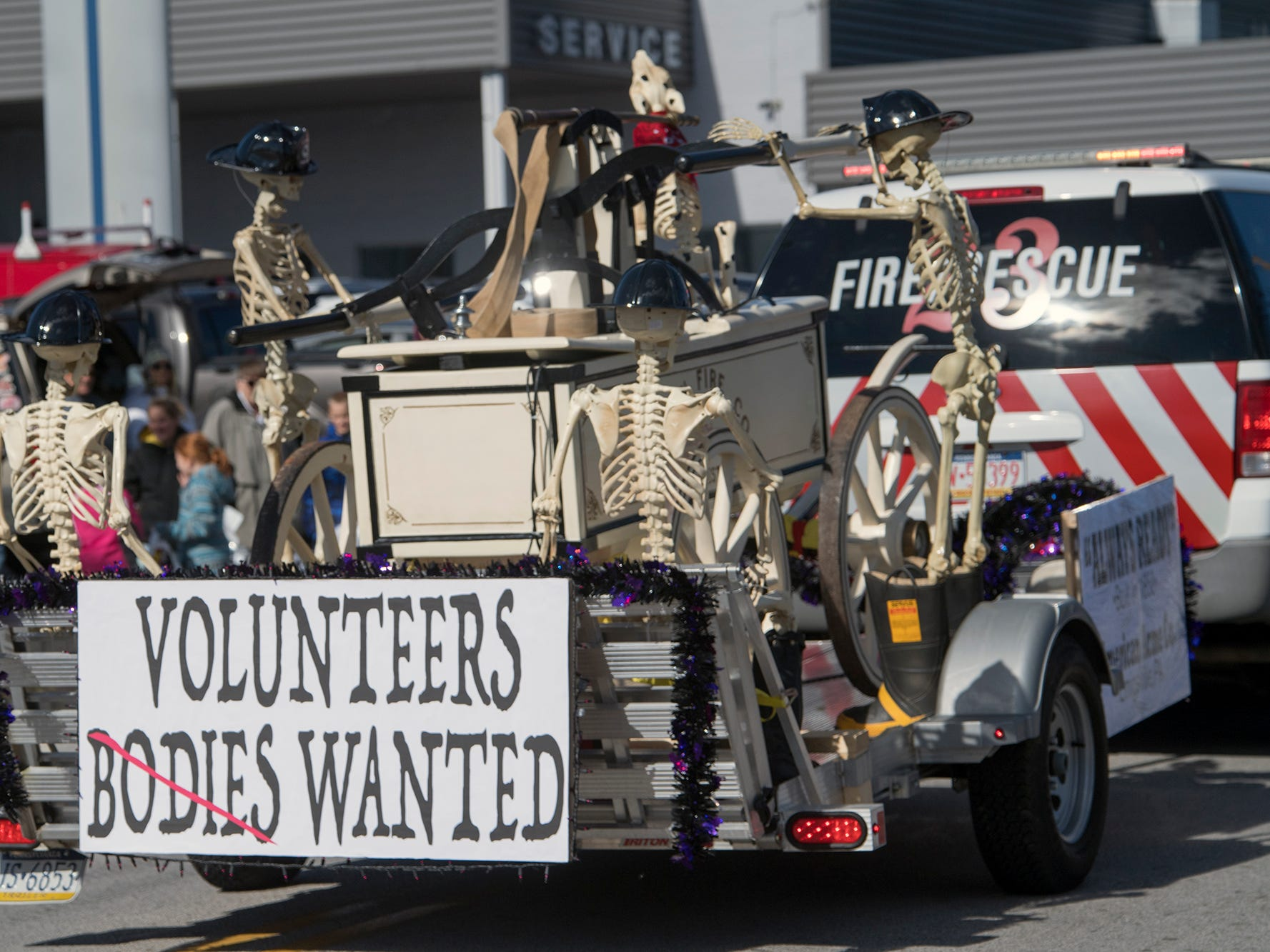 An antique fire wagon float is a request for volunteers during the 53rd Annual Manchester/Mt. Wolf Halloween Parade.