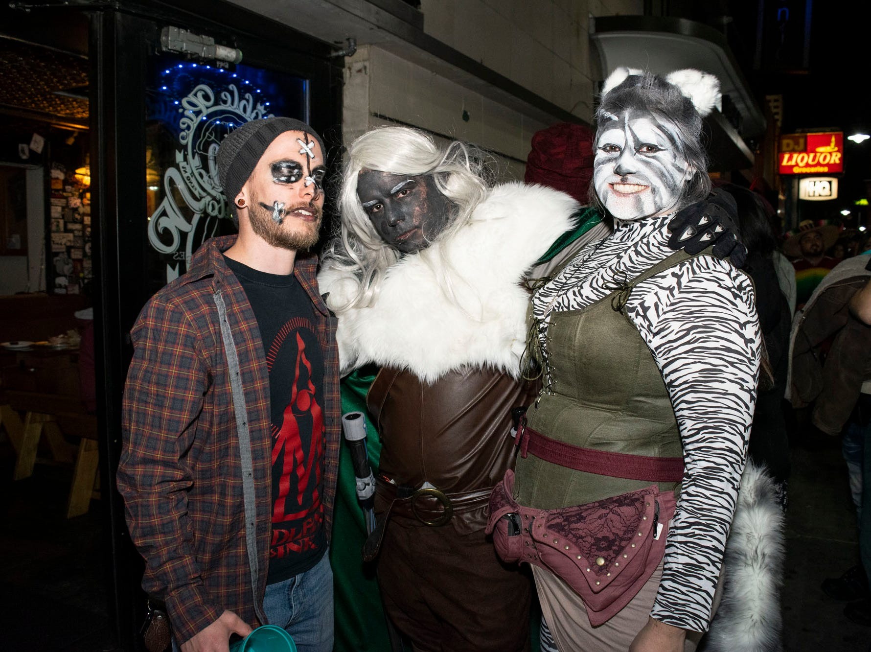 Kyake Rollins, Justin Moll, and Christina Koehlen attend the Zombie Crawl on Saturday, Oct. 20, 2018. Reno, Nev.