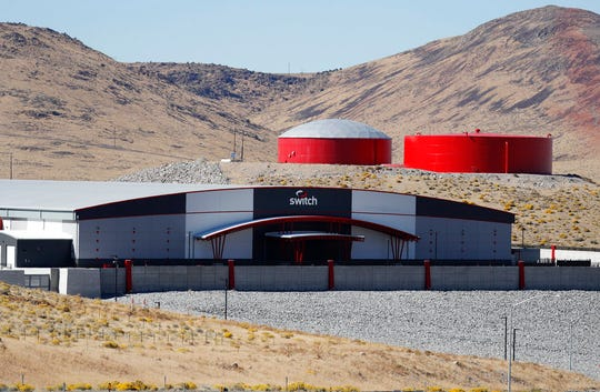 In this Oct. 13, 2018, photo, a Switch facility sits in the Tahoe Reno Industrial Center. A population inrush to Nevada has been driven by people seeking more affordable housing and a growing tech industry around Reno.