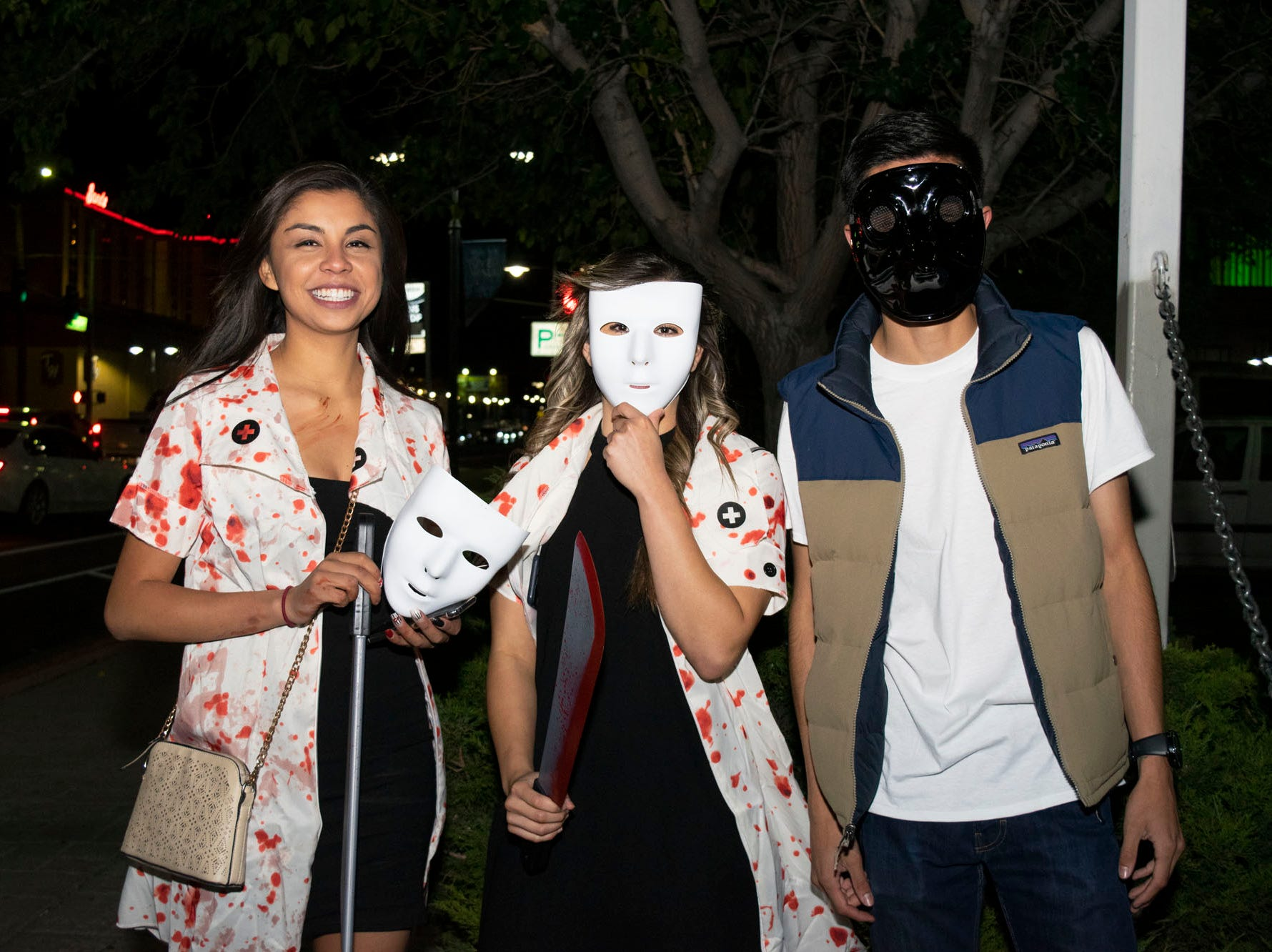 Irma Fernandez, Monique Rodriguez, and Adrian Jimeniez attend the Zombie Crawl on Saturday, Oct. 20, 2018. Reno, Nev.