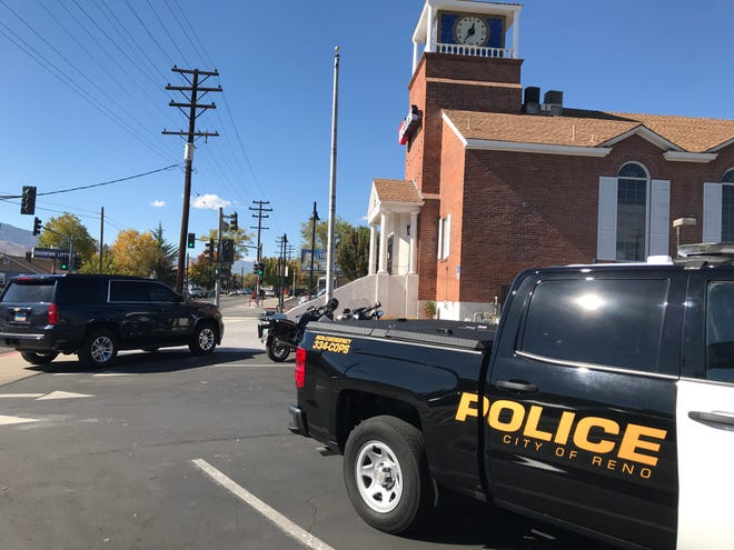 Reno Police Department vehicles outside of the US Bank on the corner of Vassar Street and Wells Avenue after thieves robbed the location on Monday, Oct. 22.