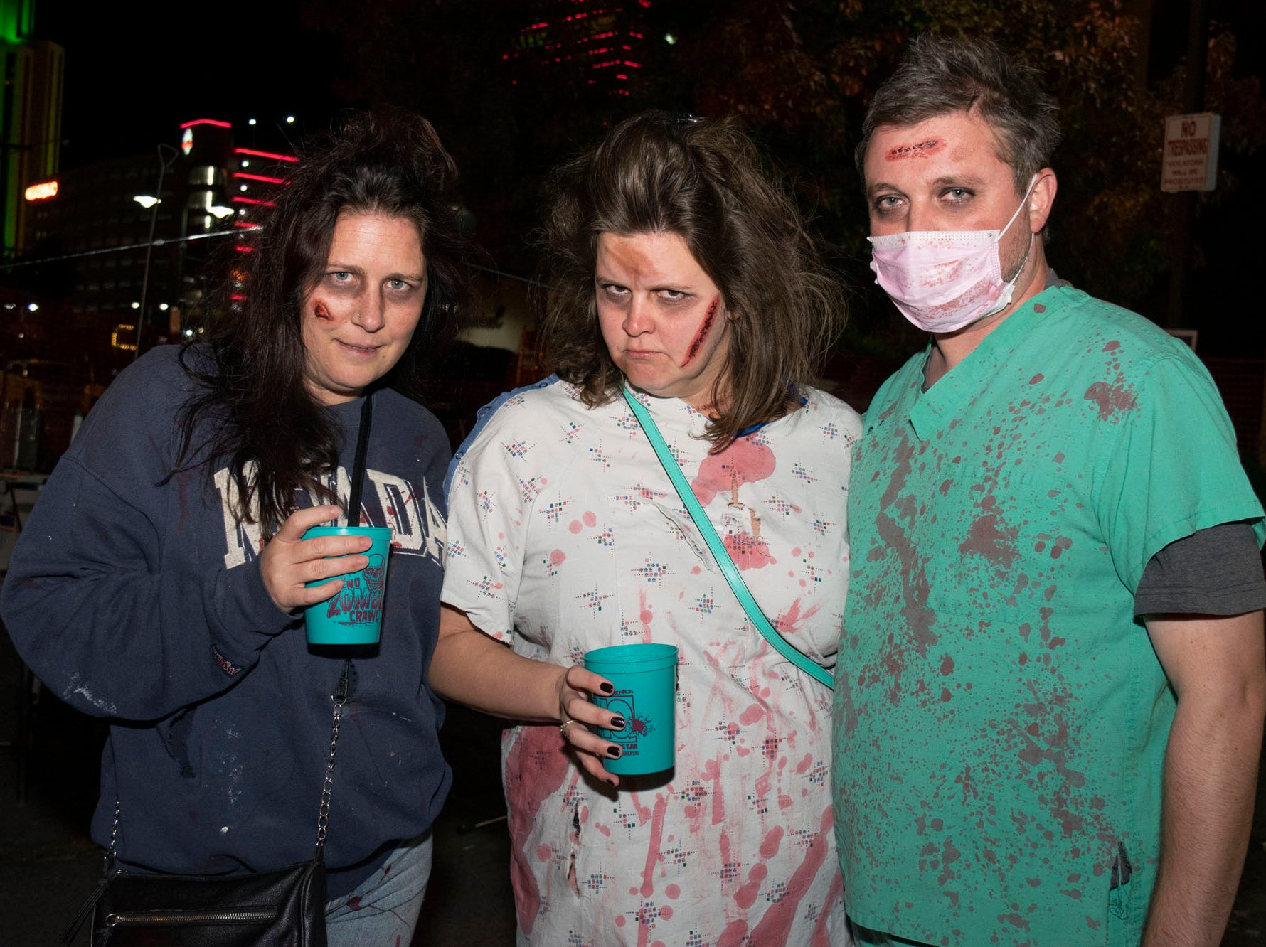 Angie Brown, Krysty Cahoon, and Ben Burke attend the Zombie Crawl on Saturday, Oct. 20, 2018. Reno, Nev.