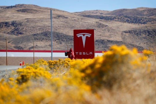 In this Oct. 13, 2018, photo, a sign marks the entrance to the Tesla Gigafactory in Sparks, Nev. A population inrush to Nevada has been driven by people seeking more affordable housing and a growing tech industry around Reno.