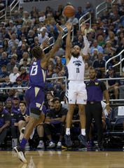Nevada forward Cody Martin (11) shoots a 3-pointer against Washington during Sunday's exhibition game.