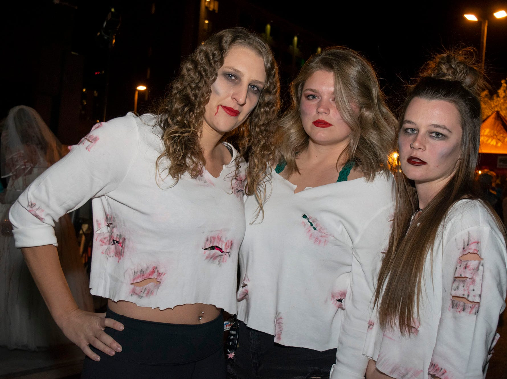 Rachel Collins, Sarah Dix, and Taylor Fagan attend the Zombie Crawl on Saturday, Oct. 20, 2018. Reno, Nev.