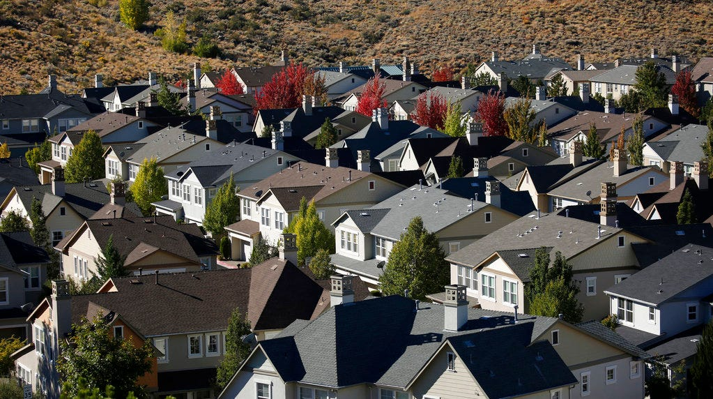 In this Oct. 12, 2018, photo, homes fill a small valley in Reno. A population inrush to Nevada has been driven by people seeking more affordable housing and a growing tech industry around Reno.