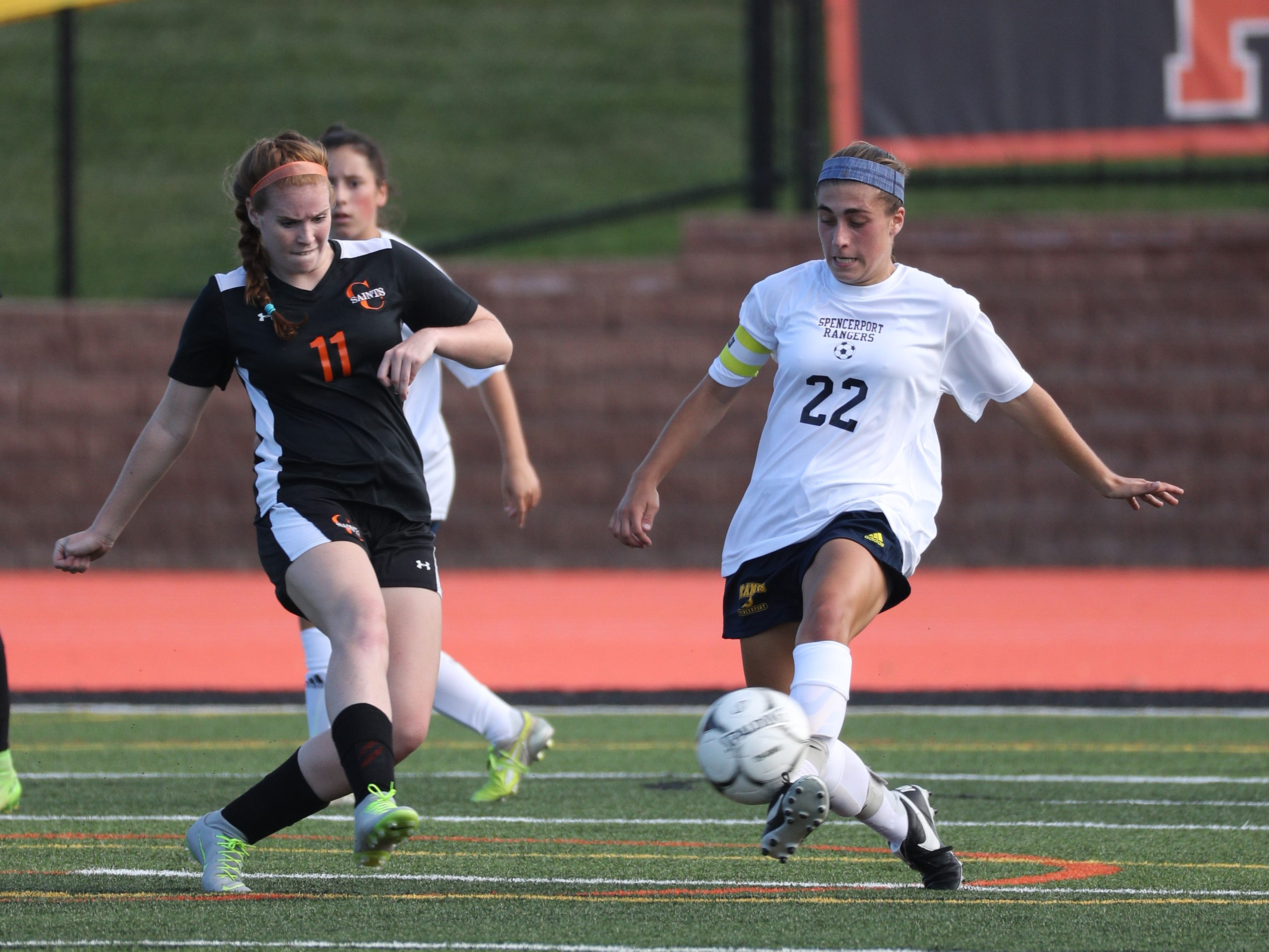 Spencerport's Olivia Wall clears the ball away from Churchville-Chili's Courtney Curley.