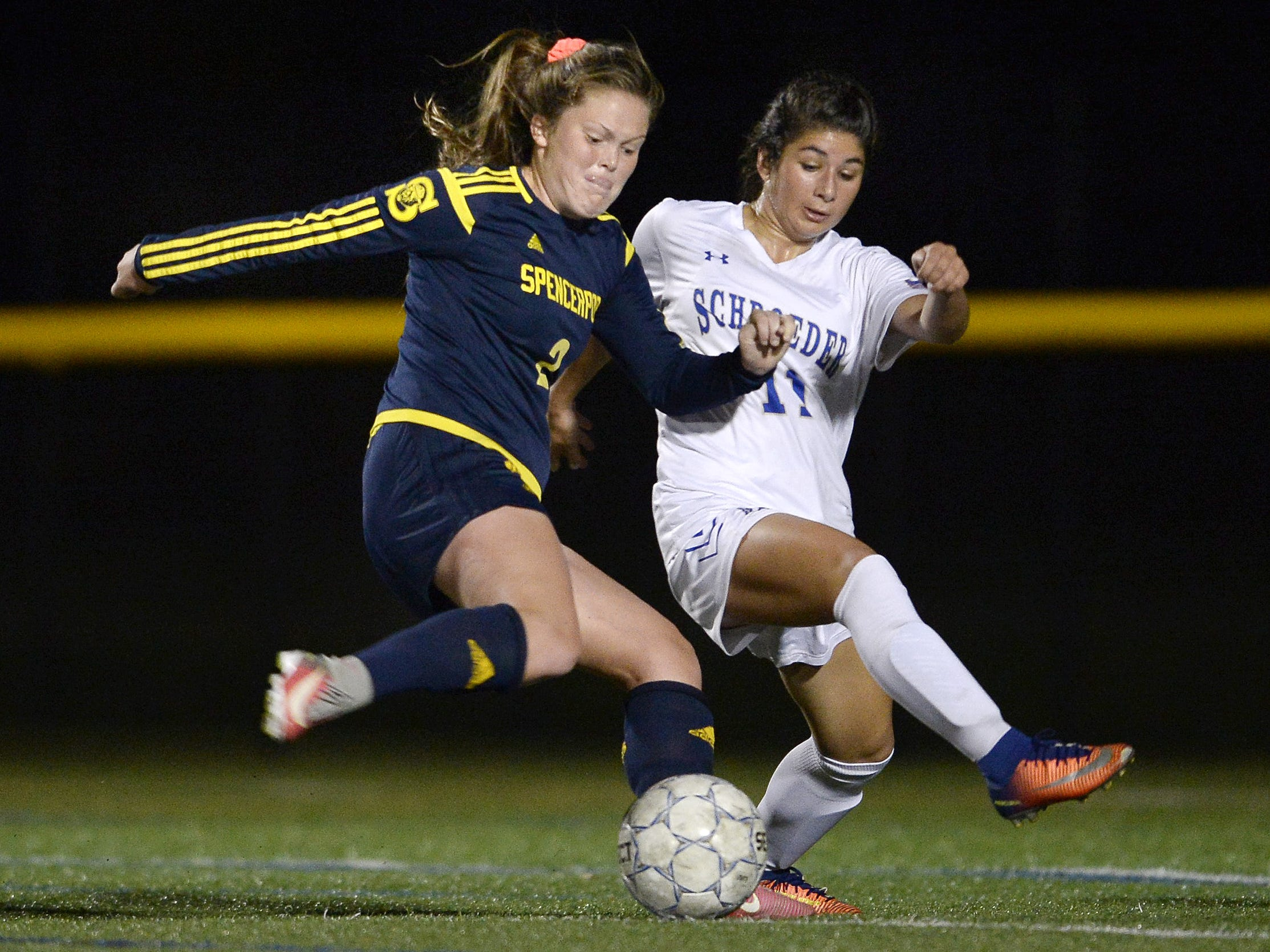 Spencerport's Erin Coykendall, left, winds up a shot on goal while defended by Webster Schroeder's Mikayla Morelli during a regular season game at Webster Schroeder High School on Tuesday, Oct. 10, 2017.