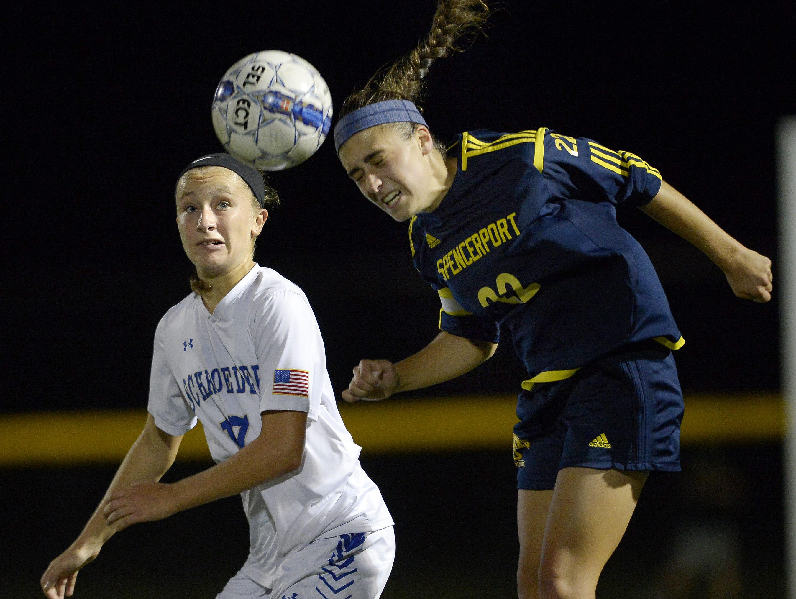 Spencerport's Olivia Wall, right, wins a header in front of Webster Schroeder's Anna Hewlett during a regular season game at Webster Schroeder High School on Tuesday, Oct. 10, 2017. Spencerport beat Webster Schroeder 4-0.