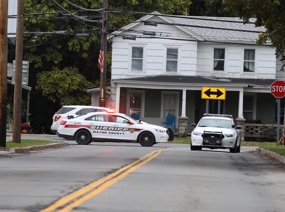 Police block streets while investigating a double homicide in Sodus.