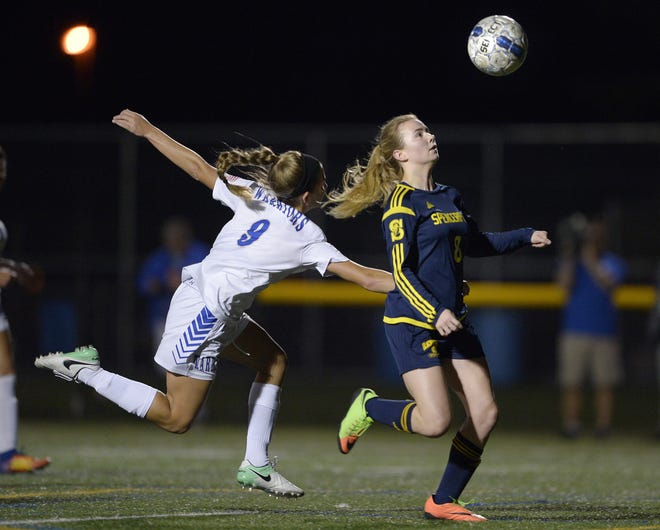 Spencerport's Leah Wengender, right, looks to control the ball after getting past Webster Schroeder's Sidney Smith during a regular season game at Webster Schroeder High School on Tuesday, Oct. 10, 2017. Spencerport beat Webster Schroeder 4-0.