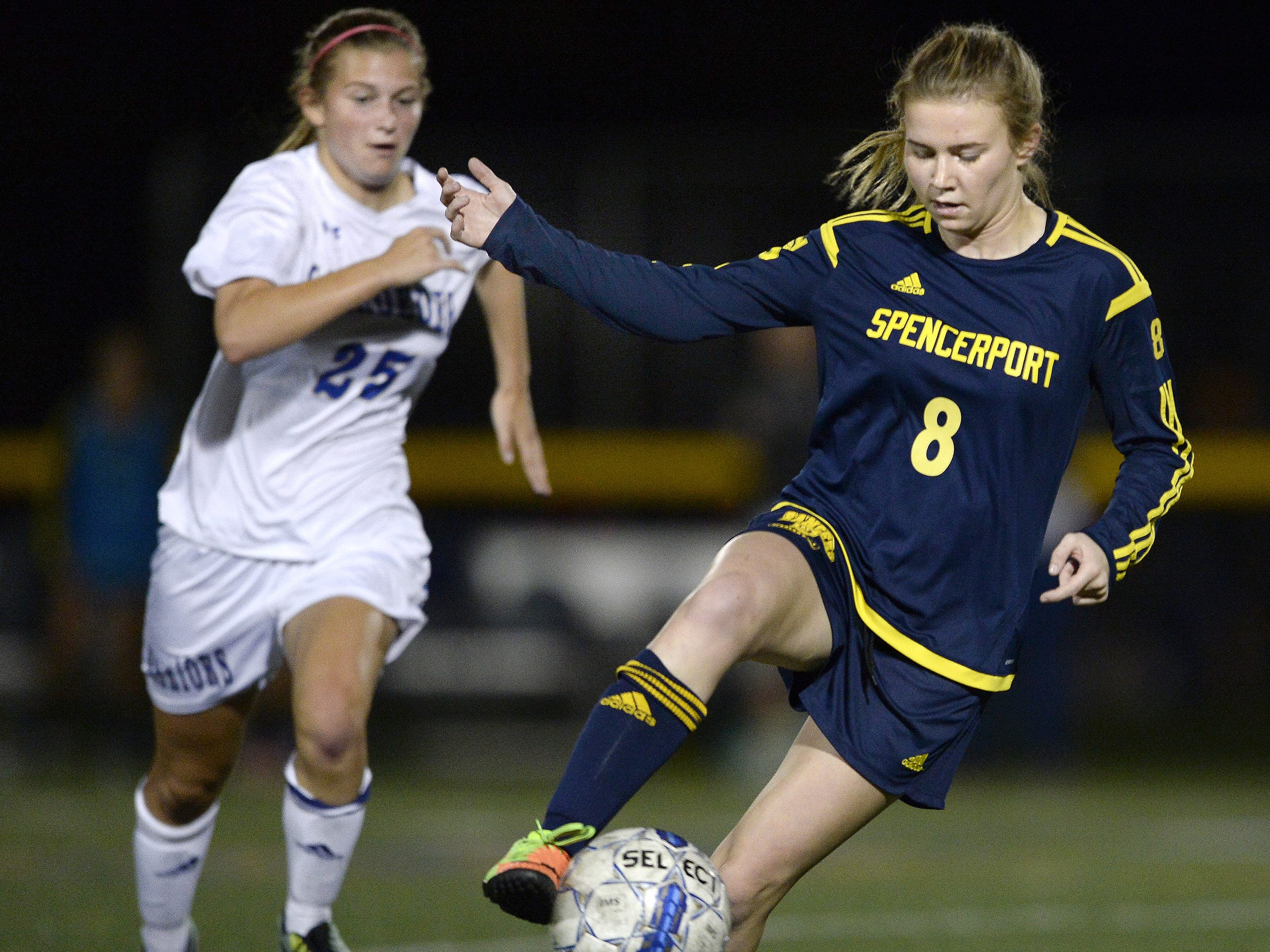 Spencerport's Leah Wengender settles the ball while pressured by Webster Schroeder's Rachel Wengender during a regular season game at Webster Schroeder High School on Tuesday, Oct. 10, 2017.