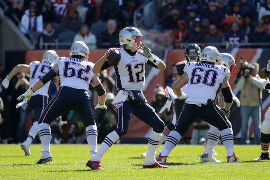 It never gets old for New England Patriots quarterback Tom Brady (12),  throwing during the first half of an NFL football game against the Chicago Bears Sunday, Oct. 21, 2018, in Chicago. (AP Photo/Nam Y. Huh)