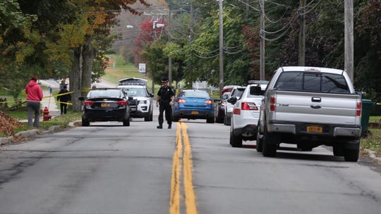 Police block off Carlton Street in Sodus while investigating a double homicide.