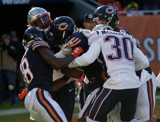 Chicago Bears Kevin White, center, catches a Hail Mary pass in the closing seconds of the fourth quarter against the New England Patriots on Sunday. Patriots kept White from scoring and preserved a 38-31 victory. They play the Buffalo Bills on Monday night at New Era Field.