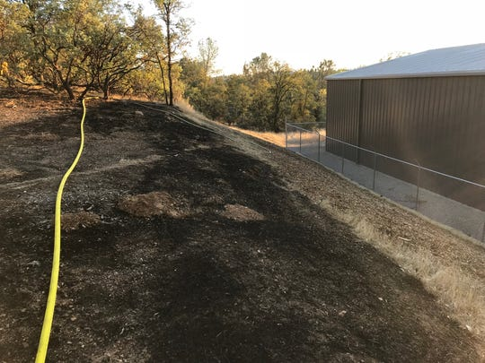 The fire off Highway 273 on Sunday afternoon came within about 30 feet of some storage units on nearby Prestige Way.