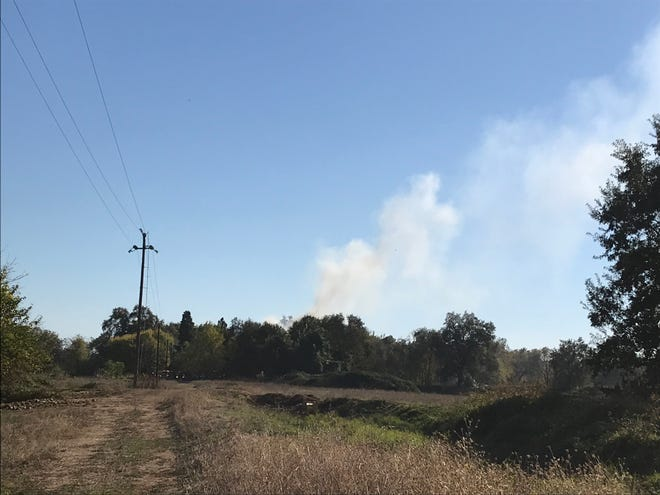Fire crews remain at the scene of a structure fire that broke out on Duncan Lane in south Redding off Interstate 5 on Monday afternoon.