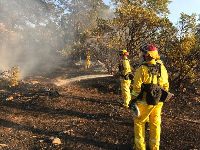 Firefighters quickly knocked down a brush and grass fire off Highway 273 in north Redding on Sunday afternoon.