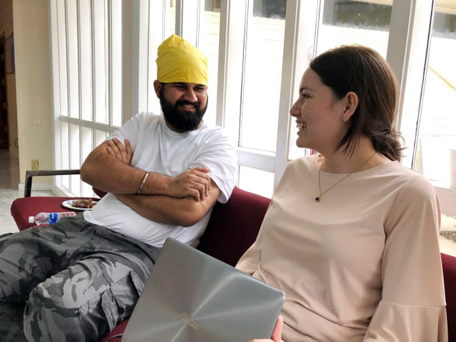 In this Aug. 23, 2018 photo, Karandeep Singh, left, a Sikh immigrant from India, speaks with Victoria Bejarano Muirhead, from Immigration Law Lab, at the Dasmesh Darbar Sikh Temple in Salem. Sikh immigrants freed from a federal prison in nearby Sheridan, have been welcomed into the temple where they can stay, get food and attend religious services.