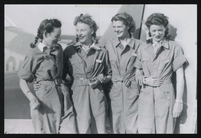 "Four WASP trainees are shown at Avenger Field in Sweetwater in April 1943. From left are: Helen Snapp, Margaret Bruns, Esther Rheinhold and Jan Tate. The trainees' uniforms, consisting of men's coveralls, were nicknamed ""Zoot Suits."""