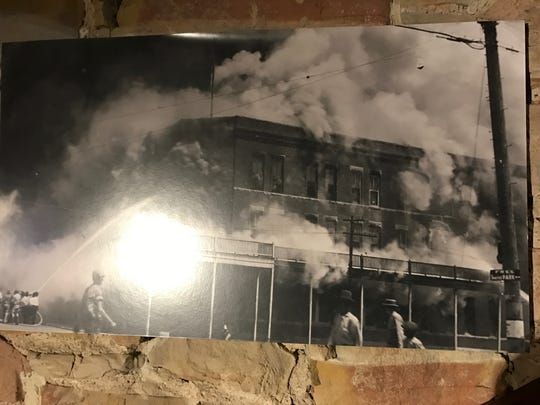 The site of a horse-drawn carriage manufacturer burns down in 1875 in San Angelo. Its location is now occupied by The Casual Pint, 19 E. Concho Ave.
