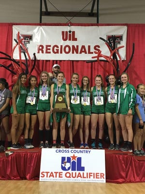 The Wall High School girls pose with their trophy after winning the Region I-3A cross country championship Monday, Oct. 22, 2018, in Lubbock.