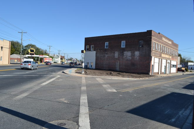 A former sex shop on this triangular lot at Route 13 and Church Street in Salisbury was razed on Sunday, Oct. 21.