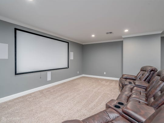 Movie night is made better with a 115 inch screen in the large theater room.