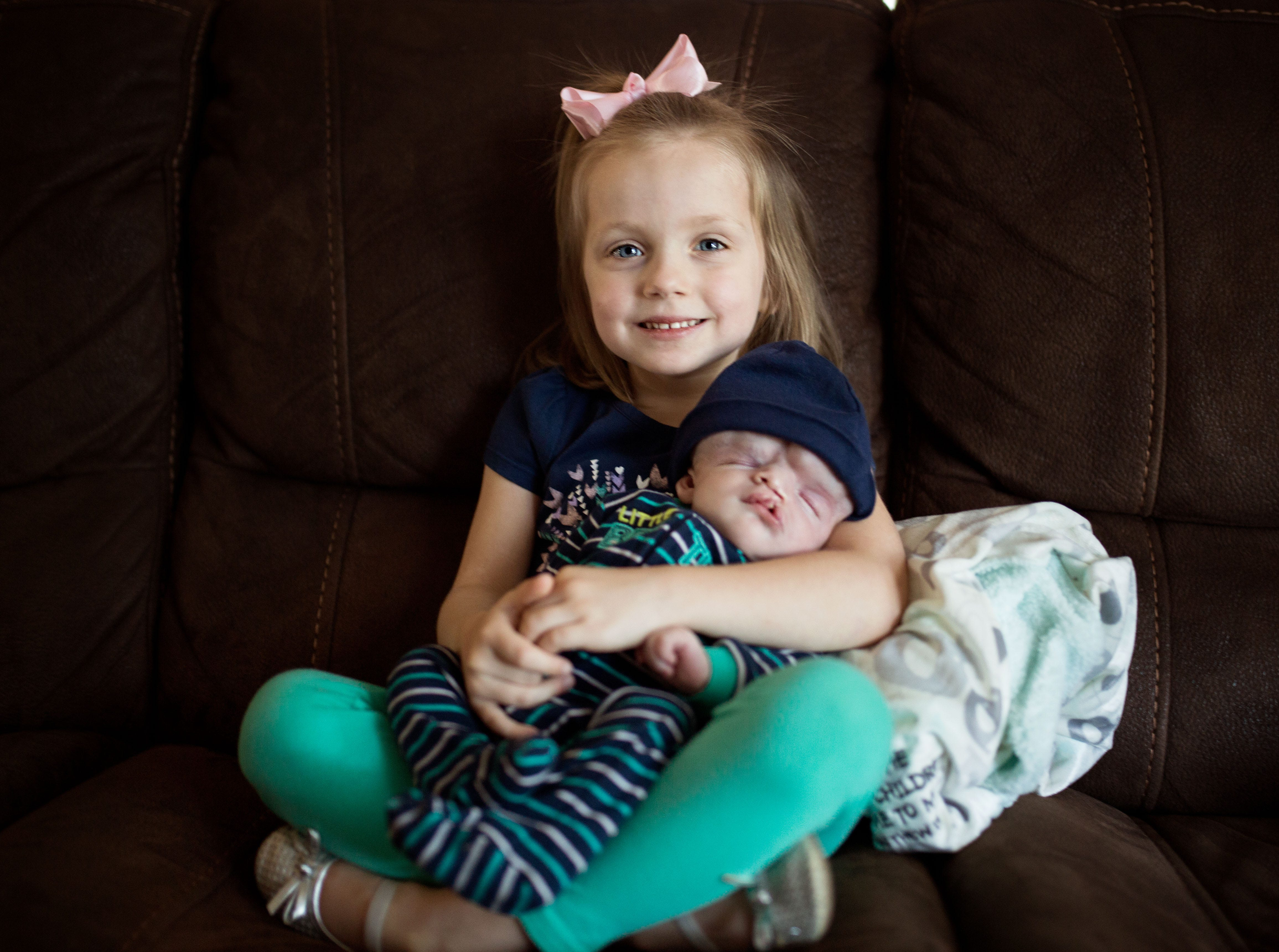 Big sister Ryleigh Masterson holds Owen shortly after he was born.