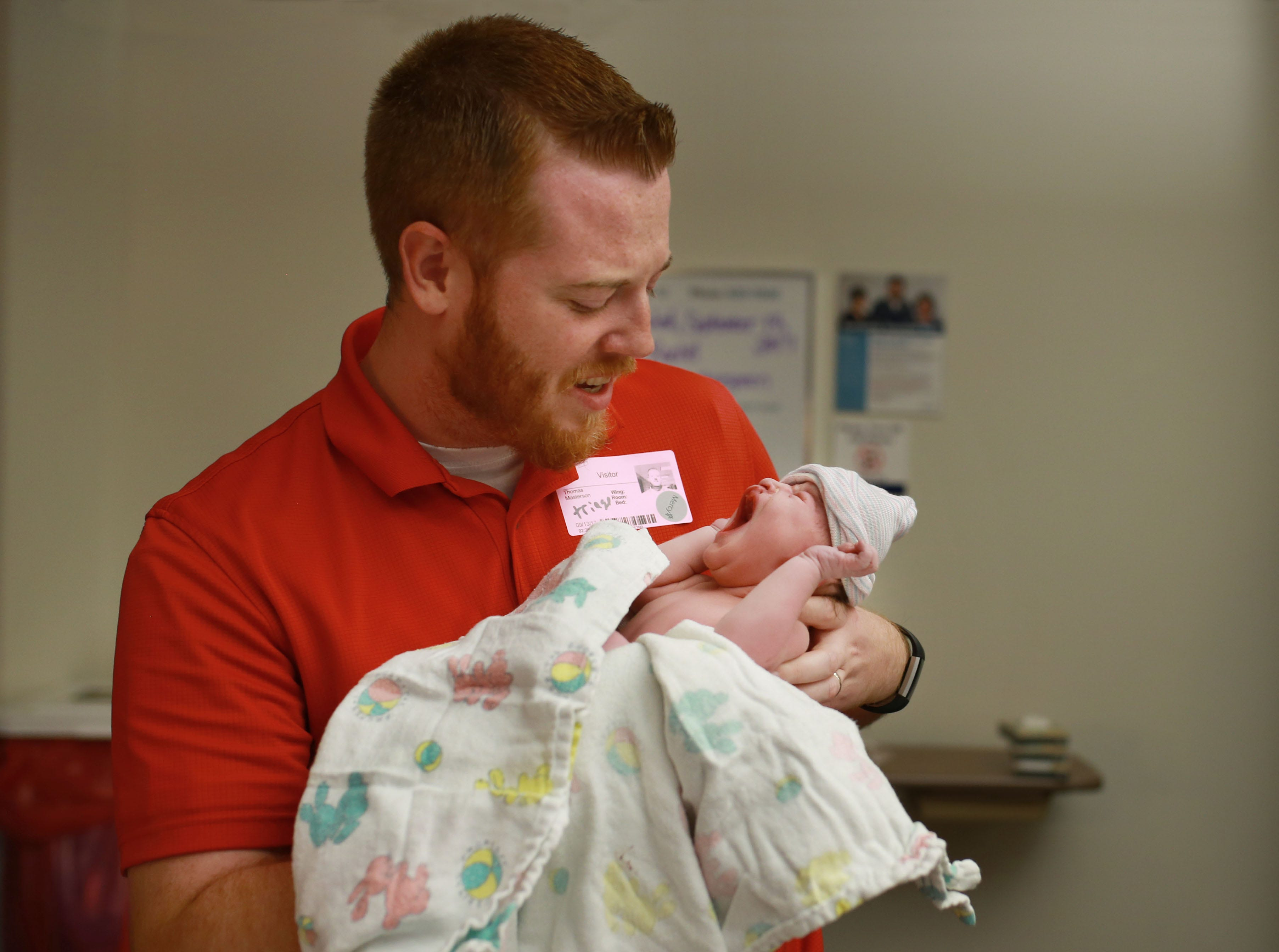 An On Angels' Wings photographer took this photo of Tom and Owen Masterson shortly after Owen was born.